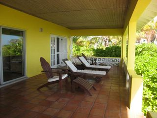 Lounge on the shady back porch, read a book, nap, gaze out at the tranquil ocean - Spanish Wells villa vacation rental photo