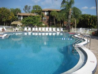 Sanibel Island condo photo - Heated Swimming Pool surrouned with lush landscape and plenty of seating