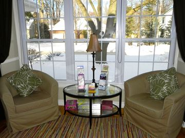 Cozy sitting area in bay window, looking out onto wintery scene in NOTL!