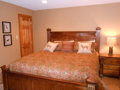 Downstairs master...king bed and tastefully decorated