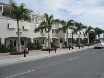 Driving on Grace Bay Road past The Plaza