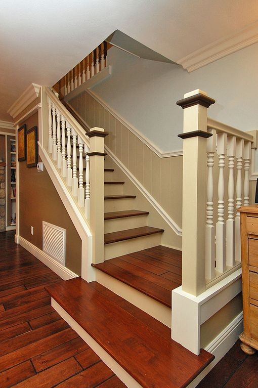 Stairs leading from main floor to upstairs bedrooms, office and entrance