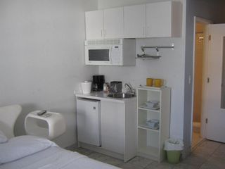 South Beach studio photo - mini-fridge / microwave / coffee maker / No stove, only electric grill hot pot