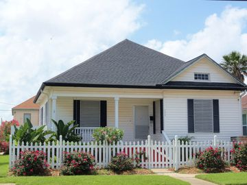 Galveston house rental - FRONT OF HISTORIC HOUSE WITH PORCH AND SWING