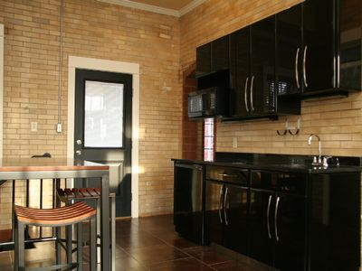 Muskegon house rental - Lower unit kitchen dining