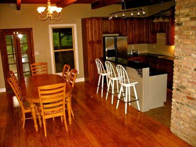 Large open kitchen and dining room. Table and bar provides seating for 10.
