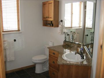 Master Bathroom. Tub to left, large walk in closet to right.