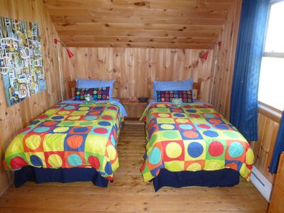 2nd floor kids bedroom with 2 new twin beds, dresser and activities drawer.
