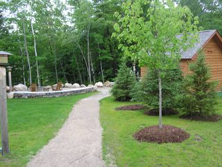 Lincoln townhome photo - Walking Path To Year Round Outdoor Hot Tub, Fire Pit & Heated Showers/Bathrooms