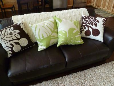 Leather couch w/ hand-stitched Hawaiian accent pillows
