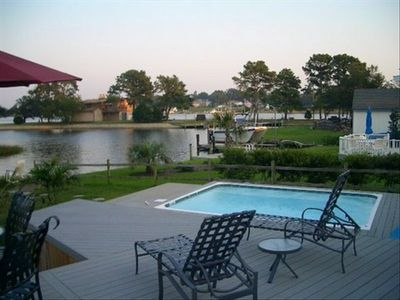 incredible waterfront spa home with tons of modern amenities .