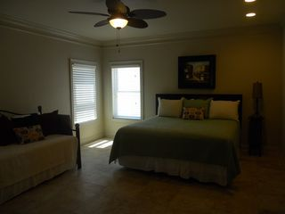 Gulf Shores property rental photo - downstairs master bedroom with view of ocean