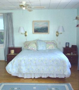 Master bedroom with water view, ground floor. Attached 1/2 bath.