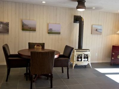 Family room in the Carriage House with wet bar, custom game table, gas fireplace