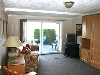 Shawnigan Lake condo rental - Ground floor family room with wallbed and sofa bed and walk out to the lake.