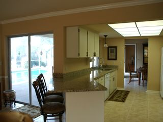 Vacation Homes in Marco Island house photo - Kitchen-Spacious; plus granite bar counter-seats 3