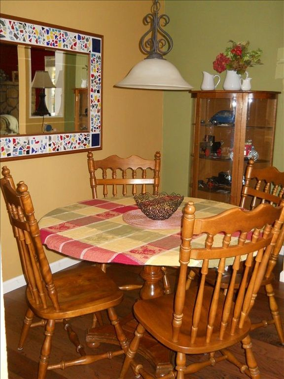 Our dining room table opens to easily seat 6+ guests.