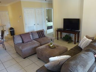 South Padre Island condo photo - Spacious living area with large LCD TV and queen size sleeper sofa