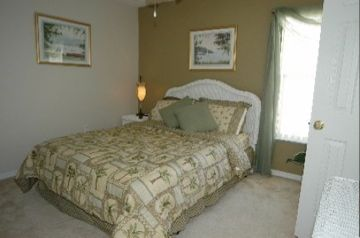 One of the queen bedded room with a shared bathroom