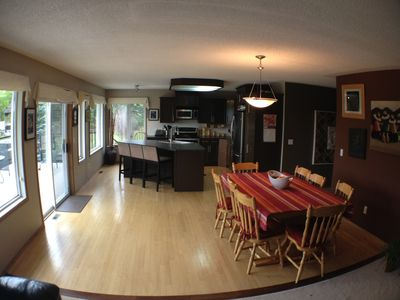 Big open concept kitchen with large dining room table for family meals