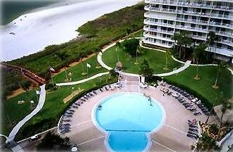 Overhead view showing condo tower, pool, and pathways to beach (Gulf).