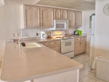 Modern kitchen with all the amenities for housekeeping.