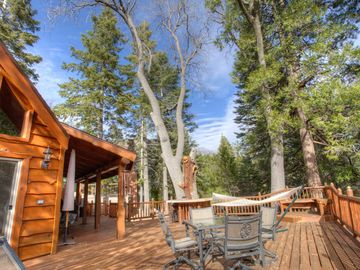 Lake Arrowhead cabin rental - View from huge deck overlooking yard with oak, ceder, sequoia, and pine trees.
