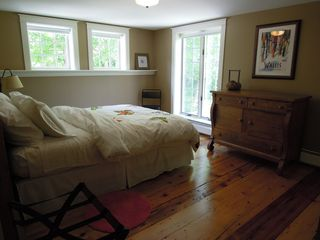 Woodstock house photo - Bedroom 1 with queen. Overlook stream. Blackout roller shades.