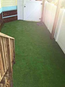 New dog yard with artificial turf; Access from porch off game rm; lockable gates
