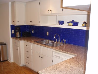 kitchen closeup with cobalt blue glass subway tile