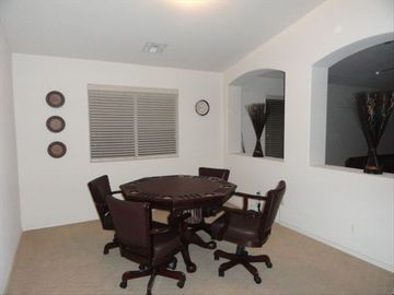 Games room with a dinning room table that can be converted to a card/poker table