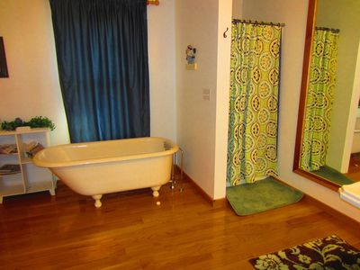 Master bathroom - with beautiful antique club-foot tub & additional shower.