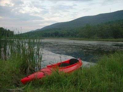 Our kayak at the pond ajoining our property.  Kayak is included in your rental!