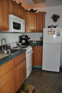 Full kitchen w/micro, stove, oven, fridge, toaster, coffee pot (NO DISHWASHER)