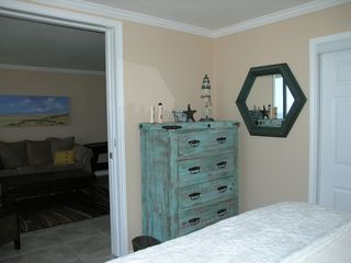 Galveston condo photo - Large chest in master bedroom and lots of closet space. Pocket door for privacy