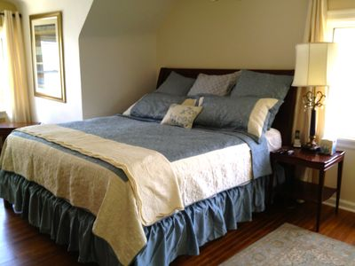 Large upstairs bedroom with king bed and vew to back yard