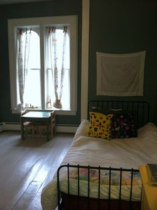 Cooperstown farmhouse rental - 3rd bedroom with a twin bed and trundle mattress beneath it.