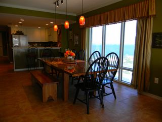 Pensacola Beach condo photo - Dining room looking into kitchen and view of island