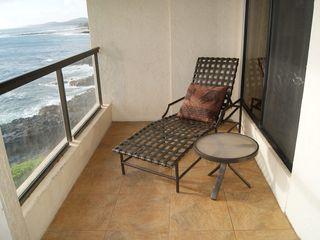 Poipu condo photo - Our oversized lanai has a chase lounge for reading or watching the shore.