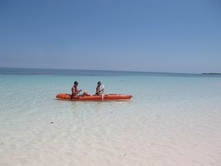 A romantic kayak ride in front of Conch Shell Beach Villa. - Spanish Wells villa vacation rental photo