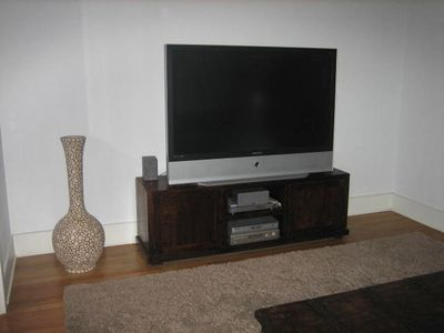 "TV room with 60"" HDTV with surround sound"