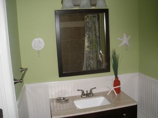 St. Simons Island condo photo - The baths are tastefully decorated and have granite countertops.