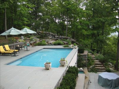 "Pool, patio seating and ""Lion Patio"" with fountain on lower level."