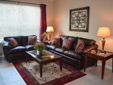 Windsor Hills condo rental - New comfortable overstuffed leather furniture with queen sofa bed. Ceiling fan.