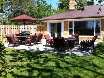 South Haven house rental - Lush Backyard with firepit table, Private and Gated.