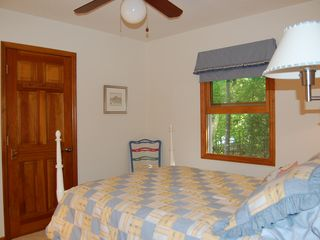 Lake Gaston house photo - another view of double bed, doors have wooden hooks and towel bars
