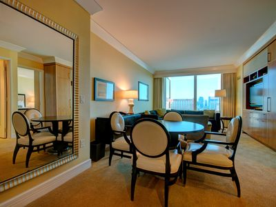 Step in to your One Bedroom Deluxe Suite with SOUTH STRIP view and enjoy it!