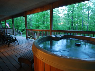 Hot tub located on huge sitting porch