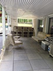 Bushkill house photo - Lower patio with BBQ