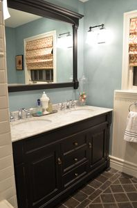 Double Marble Top Vanity with lots of space and stocked with fresh towels